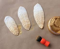 gilded feather polymer clay ornaments lines across