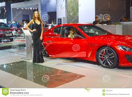 gran turismo maserati red young women from team maserati gran turismo red car moscow