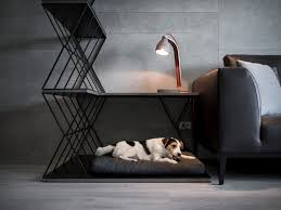 a combined dog bed side table and room divider was designed for