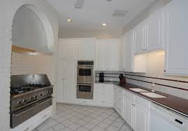 traditional kitchen with large ceramic tile u0026 raised panel in