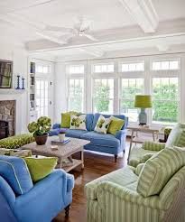 moss green and blue living room beach style with green lamp shade