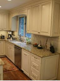 white cabinets subway tile beige granite countertops kitchen