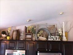 top of kitchen cabinet decorating ideas above cabinet kitchen decor crafty mally decorating above