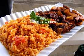 cuisine lens food and lens jollof rice with stewed beef and fried plantain
