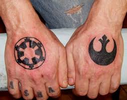 rebel alliance and imperial logo on hands conspiracy ink tattoos