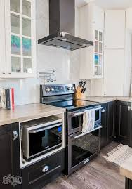 pictures of white kitchen cabinets with black stainless appliances our kitchen makeover with black stainless steel appliances