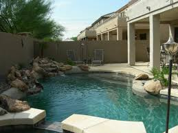 big swimming pool in modern hotel backyard with handle pools also
