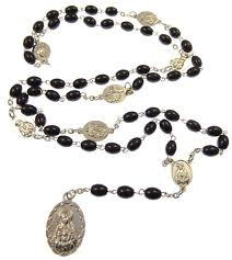 rosary of the seven sorrows black glass oval seven sorrows medal rosary