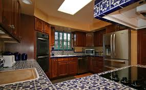 kitchen with mexican tile backsplash u shaped in albuquerque nm