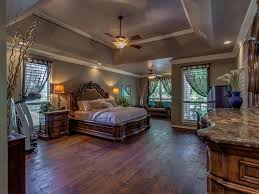 traditional master bedroom with crown molding flush light in
