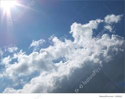 image of sun shining on clouds