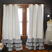Curtains With Ruffles Blackout Ruffle Bottom Grommet Curtains Two Curtain Panels