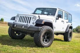 white jeep sahara 2015 zone offroad 4