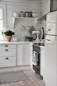 love the clean space saving cottage kitchen design the shelf with