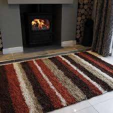terracotta orange rugs stripe shaggy rug helsinki kukoon