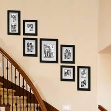 Staircase Wall Ideas 65 Awesome Arranging Pictures On A Stair Wall Ideas Arranging