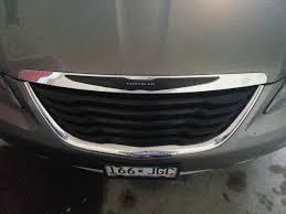 chrysler grill removing rear emblems
