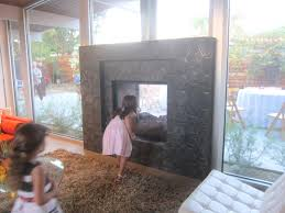 indoor outdoor fireplace see through home romantic