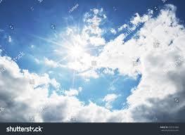 bright blue sky clouds sun rays stock photo 553221580