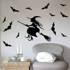 halloween wall stickers wall art kids great witch on a broom sticker with added bats surrounding her easy to apply with no damage to the wall w 42cm x h 33cm