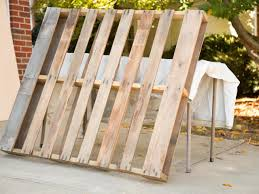 upcycle wood pallets into a cozy outdoor dog bed hgtv