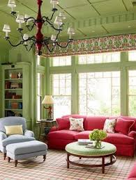 Living Room With Red Sofa by Green Living Room With Red Sofa Stool And Curtains Green Living