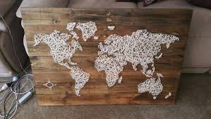 world map in string art i made with more than a thousand nails