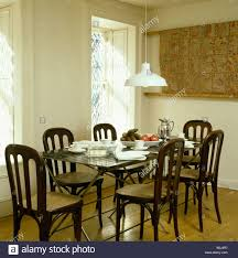 Antique Dining Room Sets by White Pendant Light Above Table Set With White China In Modern