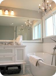 pink and grey bathroom including square ceramic glossy bathtub
