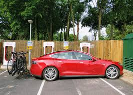 tesla model s charging spotted model s with bike rack charging up at uk service station