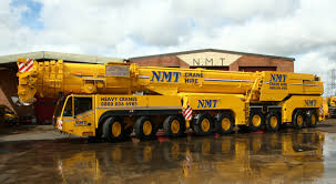 nmt uses 700 ton crane to install new footbridge section at new
