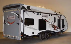 travel trailer with garage lance 2612 toy hauler swallows rzr u0027s whole with room for desert