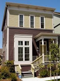 row house design photos hgtv brown and beige row house with small porch loversiq