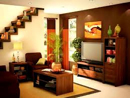 simple styled warm living room with wall tv background decoration