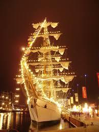 tall ships harbor lights classic sailboats
