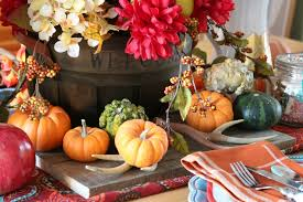 thanksgiving centerpiece and tablescape with mini pumpkins