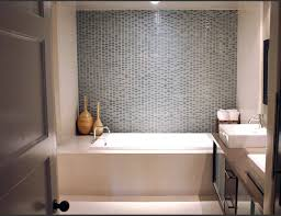 cream bathroom wall with shower areas and glass door also white