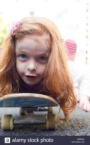 hair cute for 6 year old girls 6 year old girl with red hair on a skateboard stock photo royalty