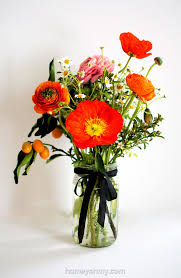 poppies flowers flower arranging ranunculus poppies and kumquats