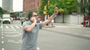 New York travelers stock images Young successful urban businessman with glasses talks on the phone jpg