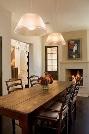 indoor picnic table dining room rustic with fireplace dark floor