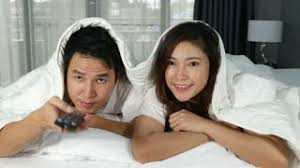 movie in the bedroom 4k of young couple watching movie on bed in the bedroom stock video