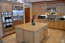 tile countertops light oak kitchen cabinets lighting flooring sink