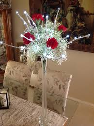 lighted branch arrangements in eiffel tower vases centerpieces