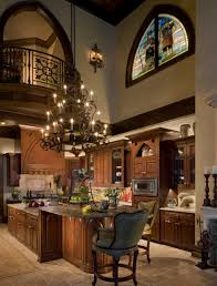 luxurious kitchen chandelier idea with brown granite countertop