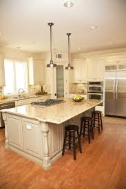 Granite Countertops With White Kitchen Cabinets by 32 Spectacular White Kitchens With Honey And Light Wood Floors