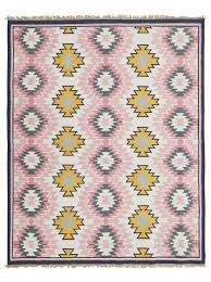 pink and green tribal rug
