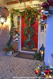Christmas Decoration For Front Of House by Front Porch Decorated For Christmas With Three Wreaths On Door And