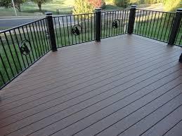 exterior design saddlebrown azek decking plus black railing for