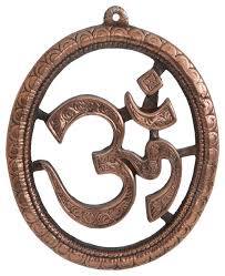 copper colored om wall hanging rustic wall art